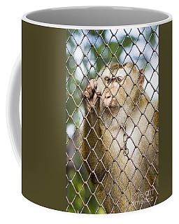Sadness In Captivity Coffee Mug