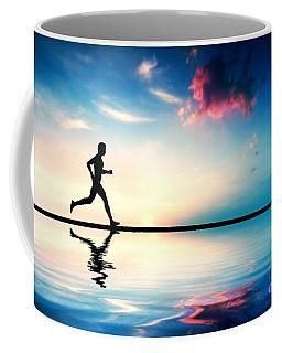 Silhouette Of Man Running At Sunset Coffee Mug