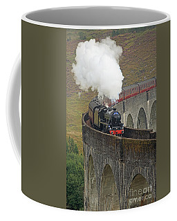 Coffee Mug featuring the photograph The Jacobite Steam Train by Maria Gaellman
