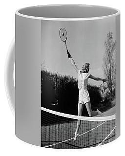 1950s Woman Jumping To Hit Tennis Ball Coffee Mug