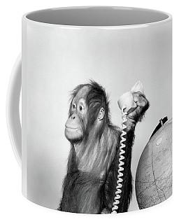 1960s Orangutan Sitting Next To Globe Coffee Mug