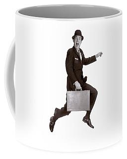 1960s Salesman Leaping In Air Holding Coffee Mug