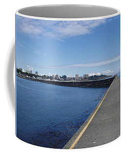 Coffee Mug featuring the photograph Along The Breakwater by Marilyn Wilson