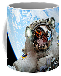 Coffee Mug featuring the photograph Astronaut Selfie During Spacewalk By Nasa by Celestial Images