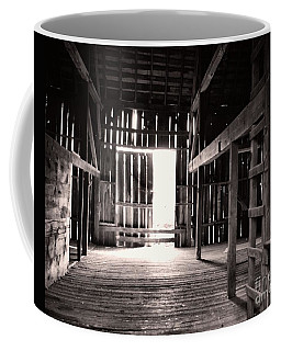 Coffee Mug featuring the photograph Inside An Old Barn by John S