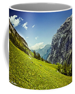 Coffee Mug featuring the photograph Lauterbrunnen Valley In Bloom by Jeff Goulden