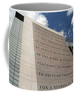 Coffee Mug featuring the photograph The Newseum by Cora Wandel