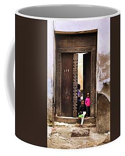 Coffee Mug featuring the photograph Kids Playing Zanzibar Unguja Doorway by Amyn Nasser