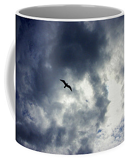 Coffee Mug featuring the photograph Storm Flyer by Marilyn Wilson