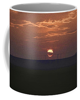 The Setting Sun In The Distance With Clouds Coffee Mug
