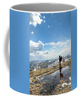 A Backpacker Stands Atop A Mountain Coffee Mug