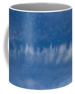 Coffee Mug featuring the photograph A Batch Of Interesting Clouds In A Blue Sky by Eti Reid