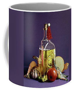 A Bottle Of Olive Oil Surrounded By A Variety Coffee Mug