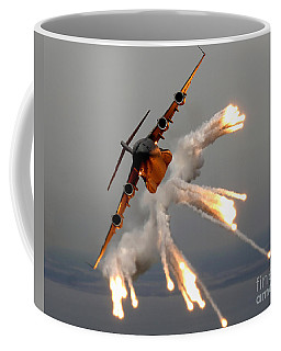 Coffee Mug featuring the photograph A C-17 Globemaster IIi Releases Flares by Stocktrek Images