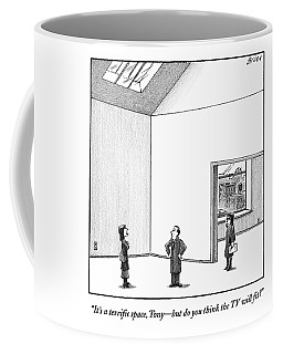 A Couple Looks At A Huge Apartment With A Real Coffee Mug