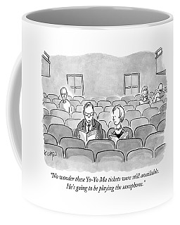 A Couple Sits Reading A Playbill Coffee Mug