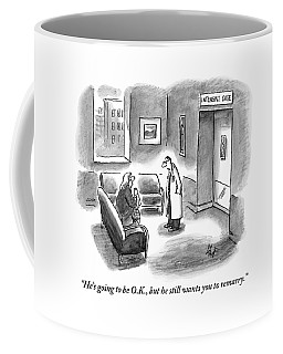 A Doctor Is Seen Speaking With A Woman Coffee Mug
