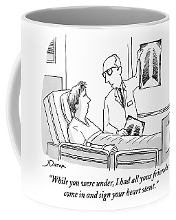 A Doctor Shows An X-ray To His Patient Who Coffee Mug