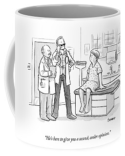 A Doctor Tells A Patient About A Hip-looking Coffee Mug