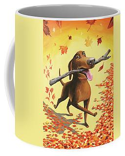 A Dog Carries A Stick Through Fall Leaves Coffee Mug