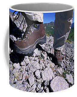 A Female Hiker Goes Up A Rocky Trail Coffee Mug