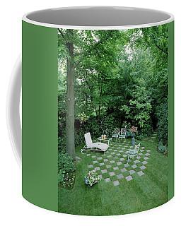 A Garden With Checkered Pavement Coffee Mug