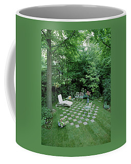 A Garden With Checkered Pavement Coffee Mug