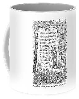 A Group Of Archaeologists Decipher A Large Coffee Mug