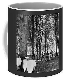 A Group Of People Eating Lunch Under Trees Coffee Mug