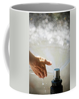 A Hand In A Playground Sprinkler Coffee Mug