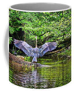 Coffee Mug featuring the photograph A Heron Touches Down by Eleanor Abramson
