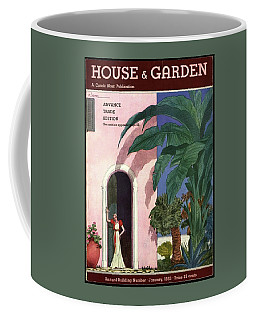A House And Garden Cover Of A Woman In A Doorway Coffee Mug