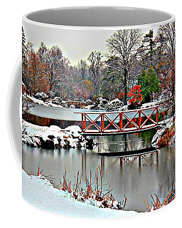 Coffee Mug featuring the photograph A Light Dusting Of Snow by Judy Palkimas