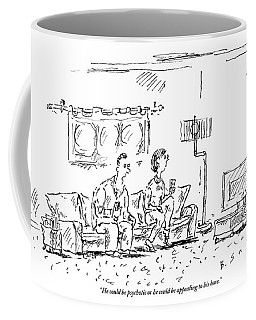 A Man And A Woman Sit In A Living Room Watching Coffee Mug