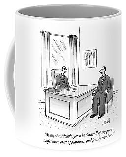 A Man At A Desk Talks To His Apparent Clone Coffee Mug