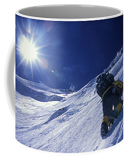 A Man Climbs A Steep Snow Covered Coffee Mug