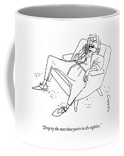 A Man With A Long Coffee Mug