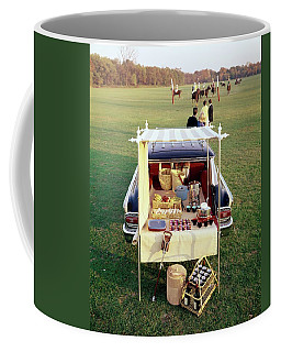 A Picnic Table Set Up On The Back Of A Car Coffee Mug
