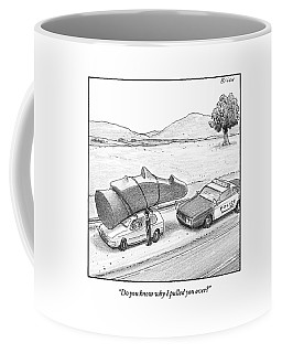 A Police Officer Has Pulled Over A Car With An Coffee Mug