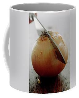 A Raw Onion Being Cut In Half Coffee Mug