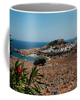 Coffee Mug featuring the photograph A Red Flower To Lindos by Lorraine Devon Wilke