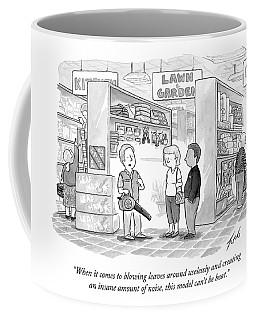 A Salesman Shows A Couple A Leaf Blower Coffee Mug