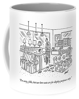 A Salesperson In A Furniture Store Addresses Two Coffee Mug