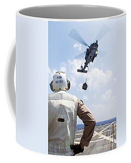 A Sh-60 R Seahawk Prepares To Drop Coffee Mug