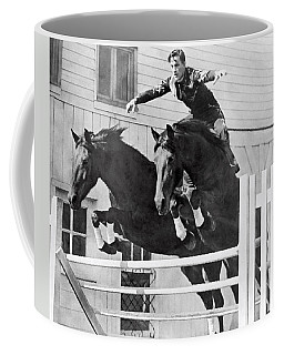 A Stunt Rider On Two Horses. Coffee Mug