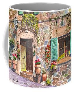 Coffee Mug featuring the painting A Townhouse In Majorca Spain by Carol Wisniewski