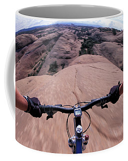 A View Of A Female Mountain Bikers Coffee Mug