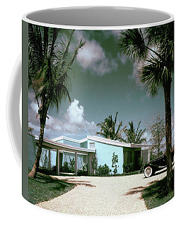 A Vintage Car Parked Outside A Blue House Coffee Mug