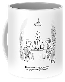 A Waiter Speaks To A Couple At A Restaurant Table Coffee Mug