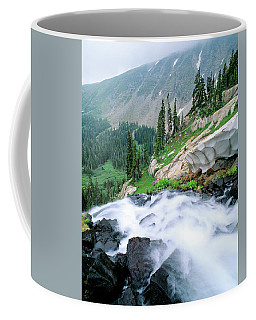 A Waterfall Flows Out Of Lake Isabelle Coffee Mug